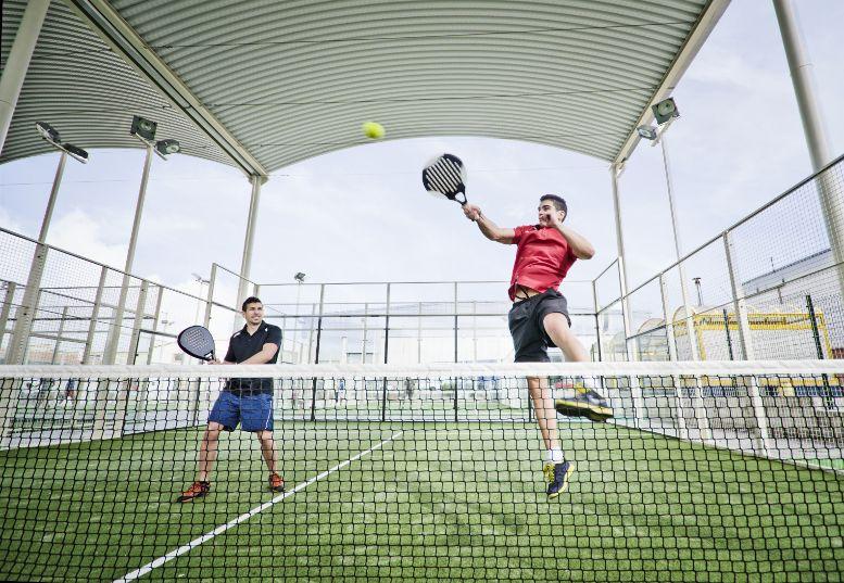 Men Playing Padel Tennis